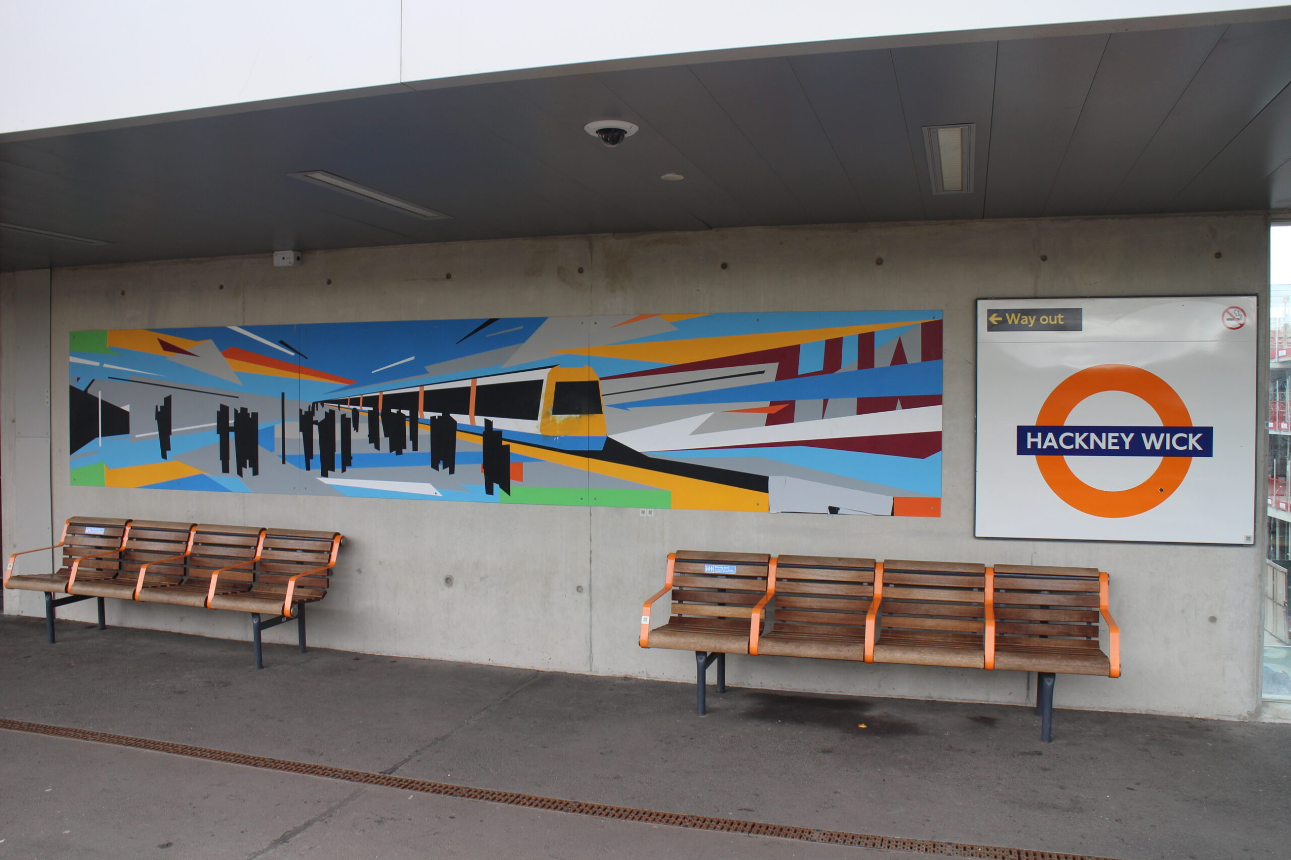 Image is of a mural commissioned by Network Rail for Hackney Wick Station created by a collaboration between John Atherton and a local street artist.